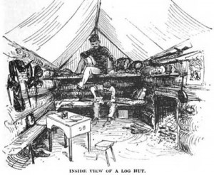 Interior of a fully-bedecked log shanty.