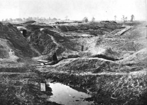 The remains of the Petersburg Crater in 1865, after a year erosion. A Federal soldier stands in it for scale.