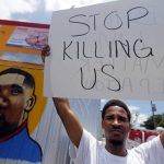 A protester demonstrates against police killings in Louisiana, July 2016.